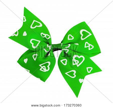 Green bow with white hearts isolated on white background