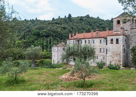 Ancient orthodox monastery surrounded by old olive trees, Mount Athos, Greece