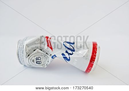 Dusseldorf, Germany - February 18, 2017: Crumpled Iron Bottles Can Of Bud Beer On White Background.