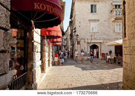 Kotor, Montenegro - August, 2016: Street with tourists walking in Kotor old town.