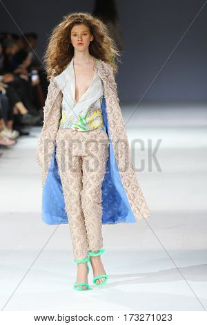 KYIV, UKRAINE - OCTOBER 13, 2016: Model walks the runway at Yulia Aysina collection show during the 39th Ukrainian Fashion Week at Mystetsky Arsenal in Kyiv