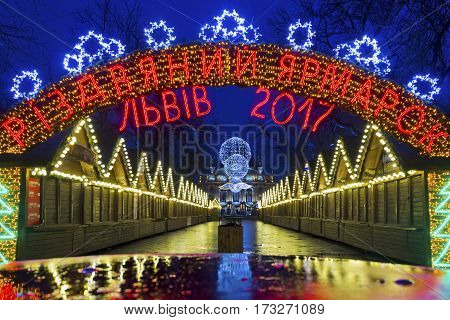 LVIV, UKRAINE - DECEMBER 11, 2016: Christmas holiday market in the center of Lviv on Liberty avenue near Opera Theater