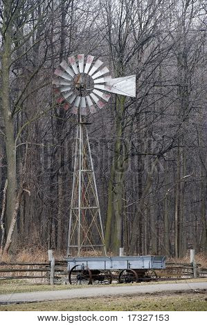 old windmill with old wagon