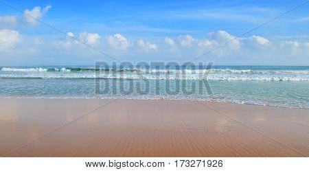 beautiful ocean, sandy beach and blue sky