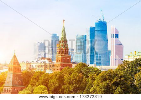 Moscow Kremlin tower with City business skyscrapers on the background