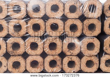 Briquettes from biomass, ecological type of heating, background
