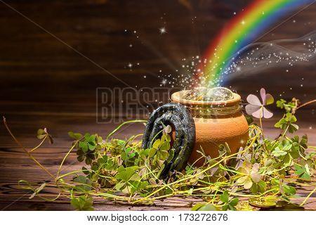 St Patricks Day Decoration With Magic Light Rainbow Pot Full Gold Coins, Horseshoe And Shamrocks On