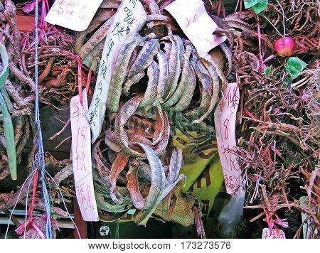 Selling dried snake skins at a street market in Hong Kong, China