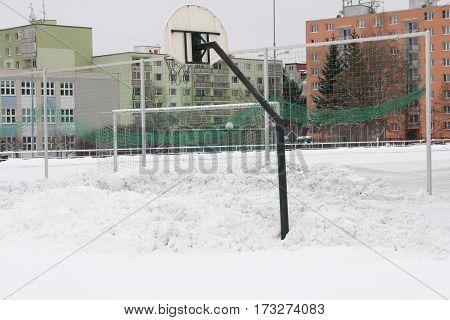 Multi-purpose playground on housing estate in winter.