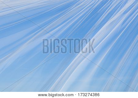 Art Abstract Decorative Tulle Background Texture. Transparent white curtain waving on the background of blue sky. Beautiful Horizontal Wallpaper With Copy Space