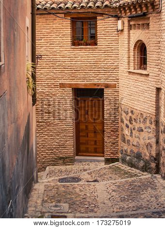 Narrow street and doorway in Toledo Spain