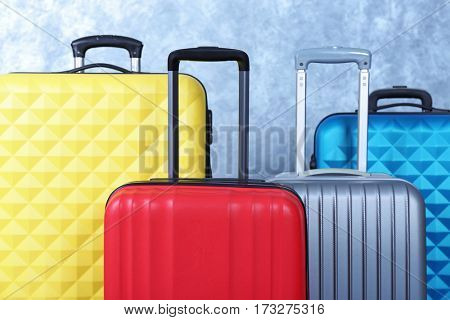 Color suitcases on light background