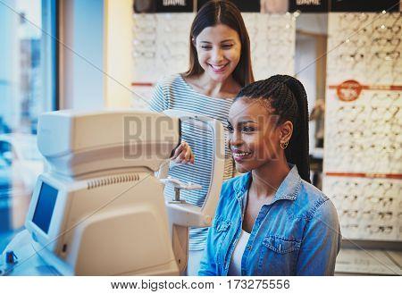 Beautiful Young Black Woman Waits To Get Eye Exam