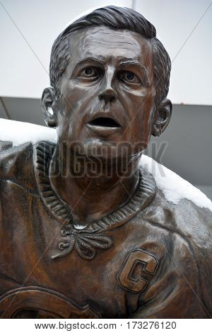 MONTREAL-CANADA 02 15 2017: Statue of Jean Beliveau former hockey player in front the Bell Center. He was inducted into the Hockey Hall of Fame in 1972.