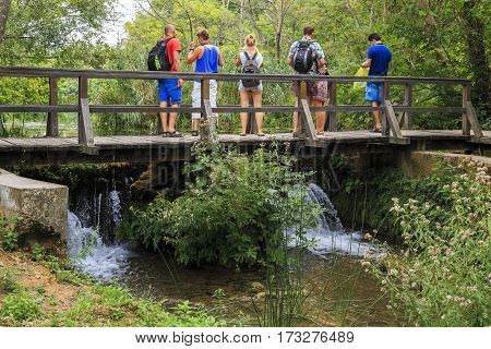 SKRADIN, CROATIA - SEPTEMBER 9, 2016: Unidentified tourists are on a tour round the Krka National Nature Reserve.