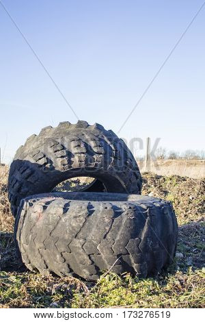 old tire of big tractor, big tractor tire, wheel tractor.