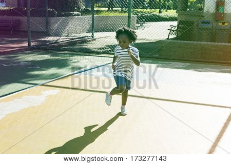 Little african girl exercise on the court