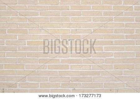 Abstract weathered Beige-brown grunge brick wall texture or old surface pattern for vintage room background and backdrop architectural element in urban concept