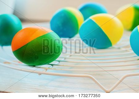 Easter eggs painted by hand yellow and blue lie on lattice