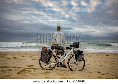 Cycle Packer With Bicycle On Beach