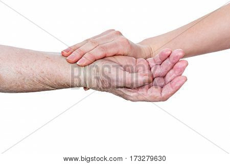 Hand doctor checks the pulse of an elderly woman on the hand, close-up, isolated on a white background