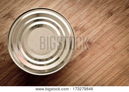 closed sprats can on wooden background close up top shot
