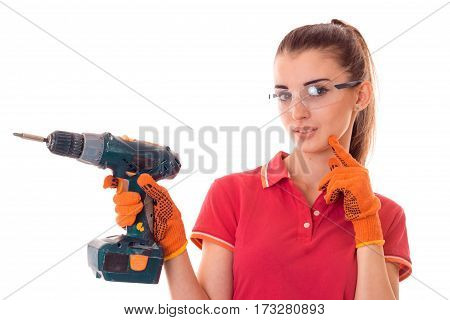 Young sexy girl in transparent safety glasses holding a drill close up isolated on white background.
