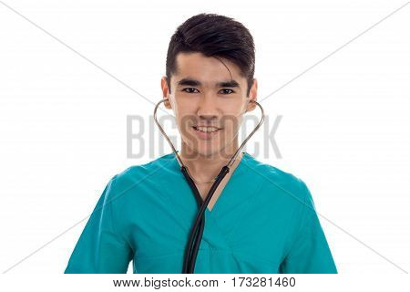 Young doctor with stethoscope in his ears close up isolated on white background.