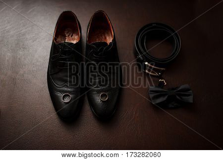 Brown Leather Men's Shoes With Accessories And Wedding Rings. Set Of Groom.