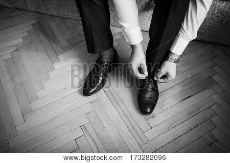 Man Wear Shoes. Groom At Wedding Day. Black And White Photo