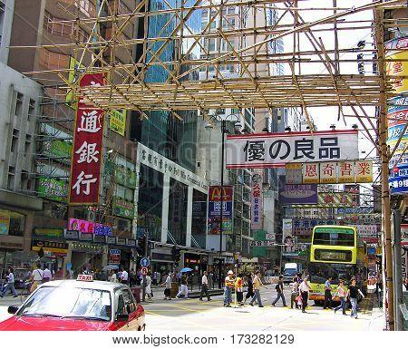 Mong Kok, Hong Kong - March 23, 2003: Busy street in the district Mong Kok in Hong Kong.