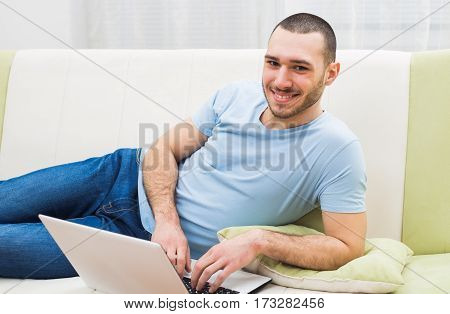 Young man  using laptop at his home.
