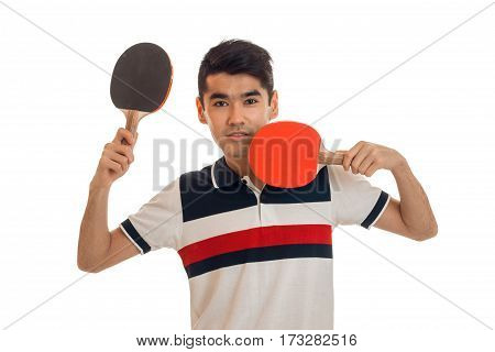 young guy picked in the hands of rackets for table tennis is isolated on a white background