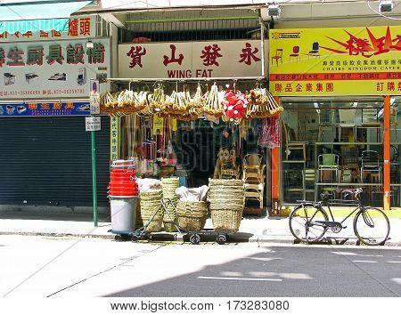 Yau Ma Tei, Hong Kong - February 23, 2003: Traditional shops for household items and furniture in Yau Ma Tei (Hong Kong).