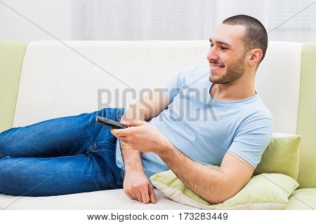 Man enjoys watching television at his home.