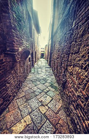 a narrow backstreet in Tuscany in Italy