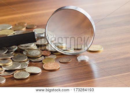 Different Collector's Coins With A Magnifying Glass, Soft Focus Background