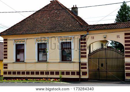 Typical peasant house in the village Codlea, Transylvania, Romania.