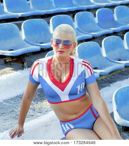 the sports blonde on steps of stadium a subject of the woman and sport
