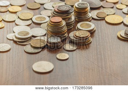 Different Gold Nad Silver Collector's Coins On The Wooden Table