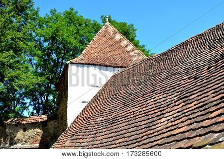 Fortified medieval saxon church Crit-Kreutz, Transylvania. The villagers started building a single-nave Romanesque church, which is uncommon for a Saxon church, in the 13th century. poster