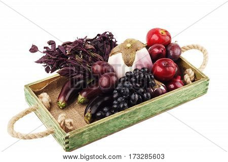 Set Of Different Violet Vegetables And Fruits In The Wooden Tray