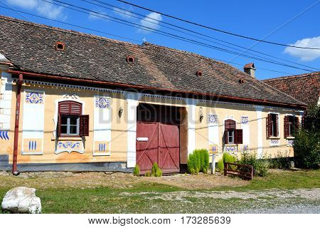 Typical houses in the village Viscri, Transylvania. The fortified church in this village was built around 1100 AD.