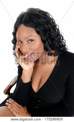 A closeup portrait of an African American woman in a black dress and big boobs and curly hair isolated for white background.