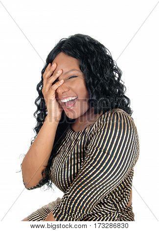 A beautiful African American women laughing from the bottom of her heart isolated for white background.