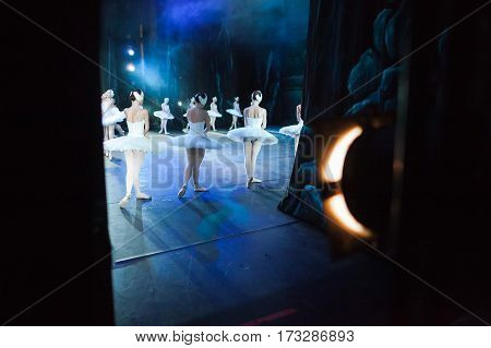 Ballet swan lake. Ballet statement. Ballerinas in the movement. Feet of ballerinas close up.