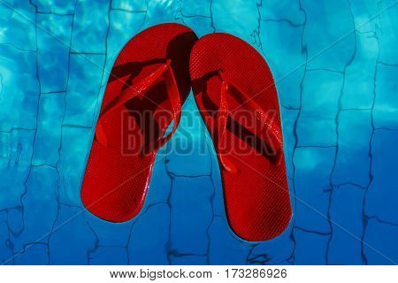 Red Flip-flops Floating In A Swimming Pool, A Top View