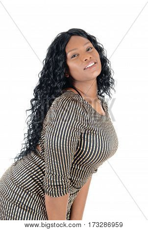 A beautiful African American woman standing in a dress and smiling isolated for white background.