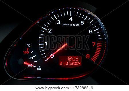 tachometer on a car dashboard closeup shot