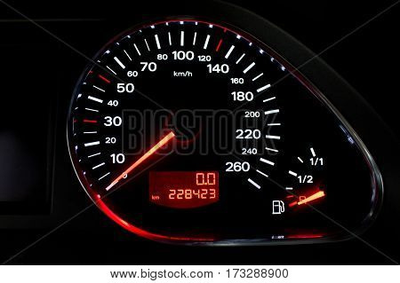 speedometr on a car dashboard closeup photo